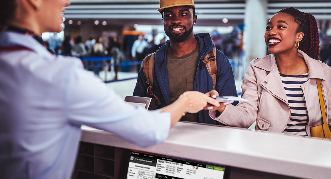 Passengers checking-in at an airport desk